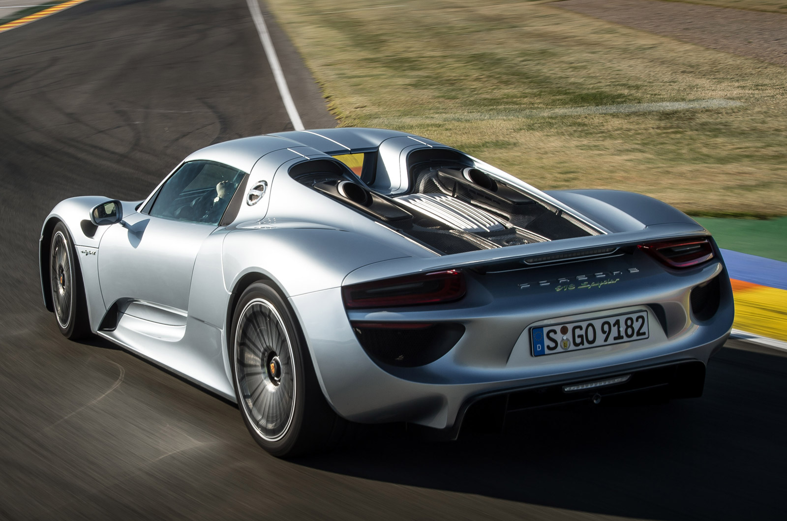 the rear engined 918 spyder has a top speed of 215mph. Black Bedroom Furniture Sets. Home Design Ideas
