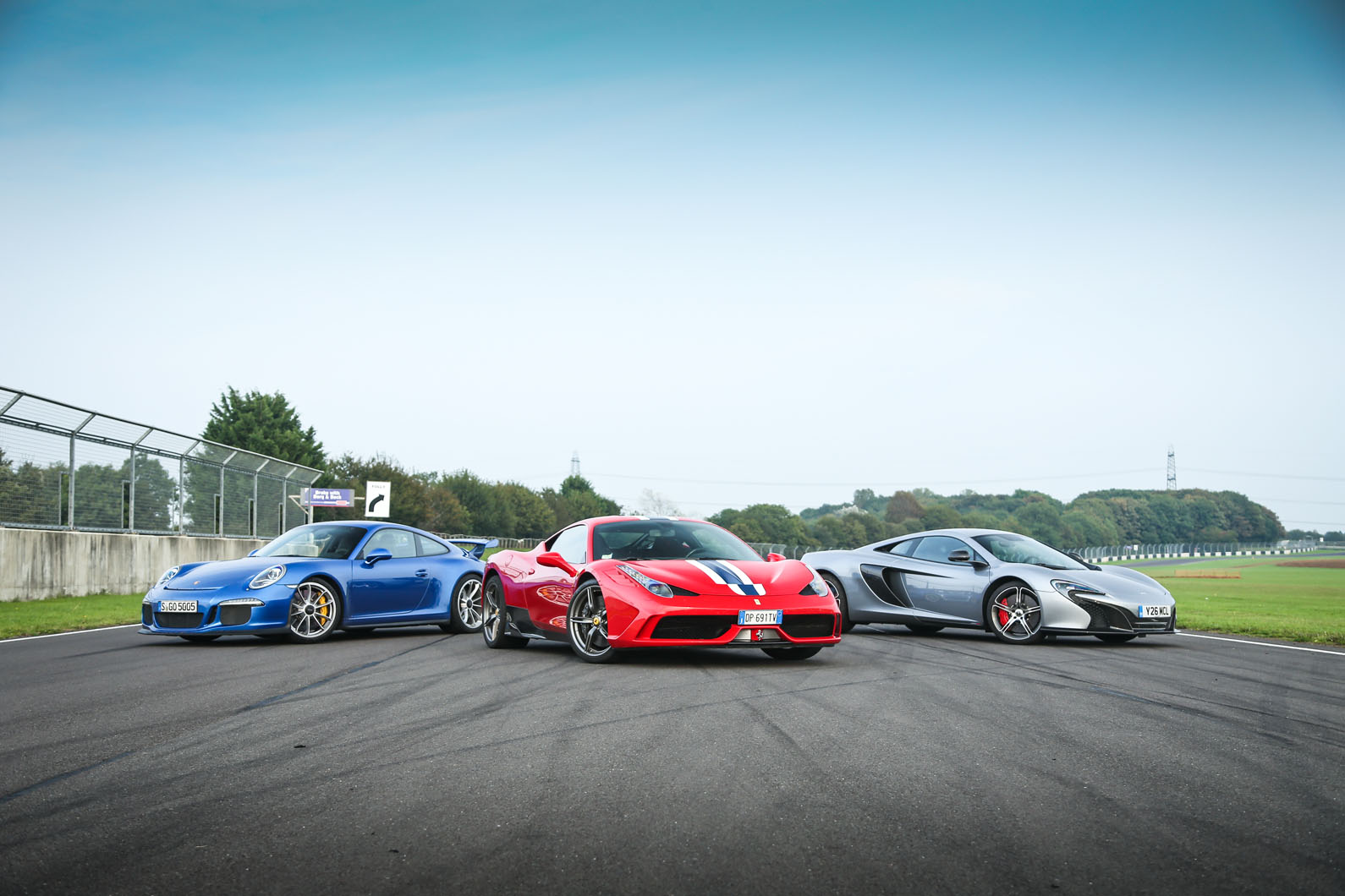 These three are sure to be at the business end of this year s contest ferrari s achingly brilliant 458 speciale versus mclaren sunfeasibly potent 650s