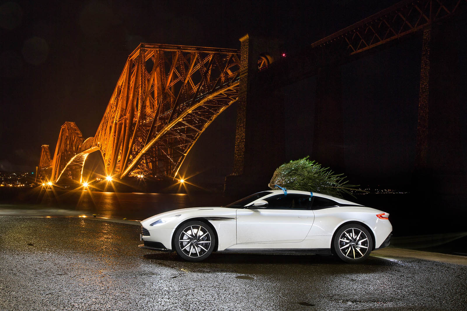 Christmas Sports Car.Aston Martin Db11 Delivering A Christmas Tree From Scotland