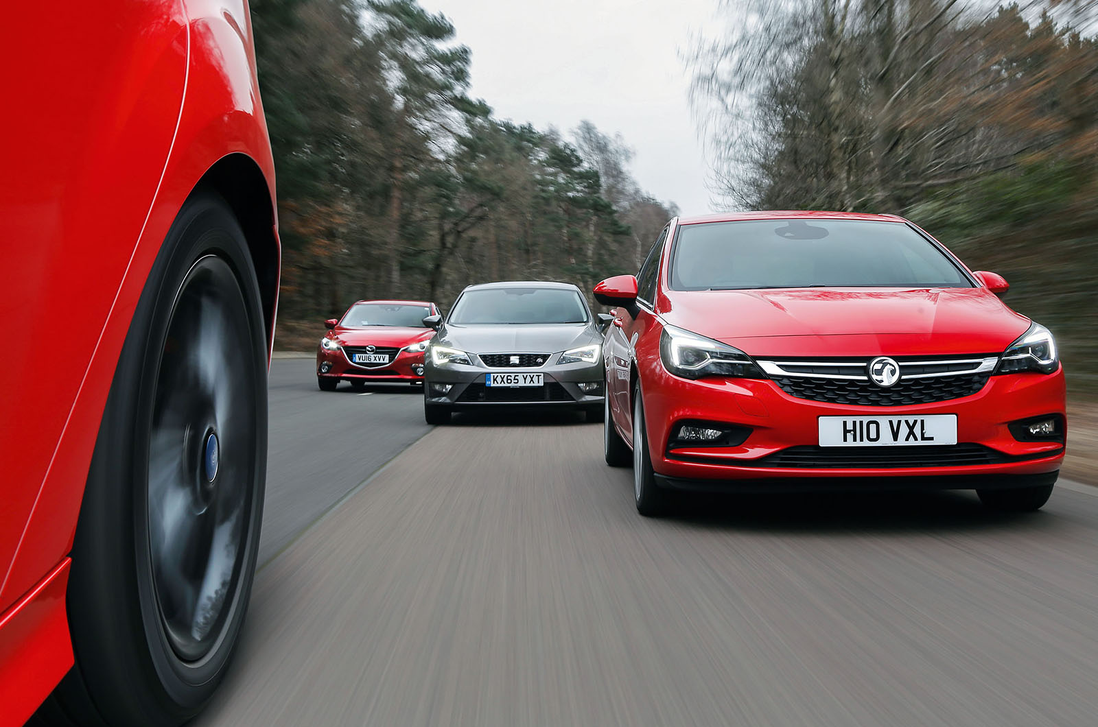 Seat leon ford focus vauxhall astra versus mazda 3 warm hatch group test autocar