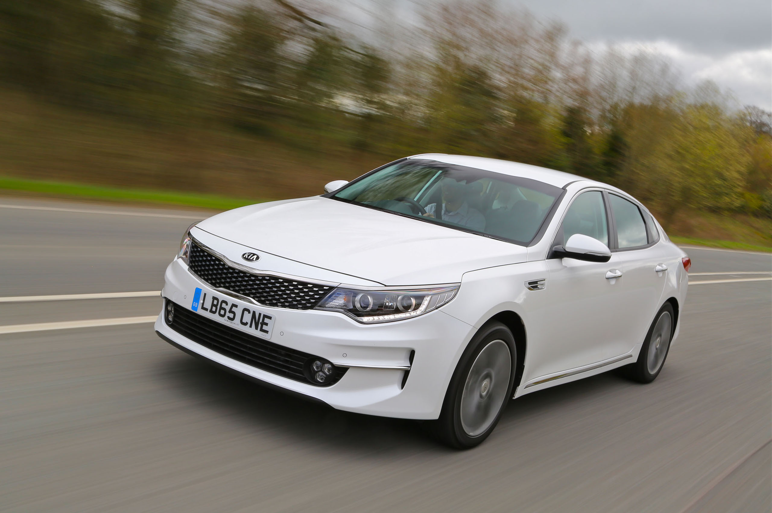 trend quarter first motion loaded three en motor review front optima in lx test kia fully news