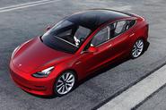 Red Tesla Model 3 press photo