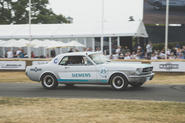 Going up Goodwood hill in a 1965 Mustang… that drives itself