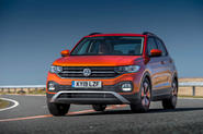 Volkswagen T-Cross front three quarters on the road