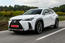 Lexus UX front three-quarter on road