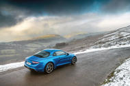 Alpine A110 parked on a mountain road - rear