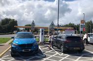 The Kia e-Niro meets a (diesel) BMW X6 in an electric charging bay