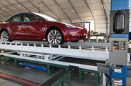 First Tesla Model 3 Dual Motor produced on temporary production line