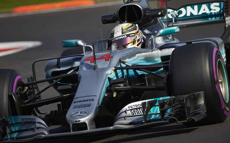 Lewis Hamilton has secured his fourth drivers' world championship, setting a new record for the most titles by a British driver.