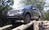Range Rover traversing logs