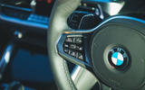 15 BMW 4 Series M440i road test review 2021 steering wheel