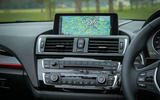 A close up of BMW's iDrive infotainment system in the 2 Series convertible