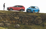 Audi and Volvo on ledge