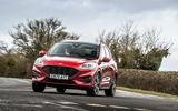 20 Ford Kuga FHEV 2021 UK FD cornering front