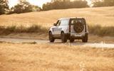 21 Rover Defender PHEV 2021 UK FD driving rear