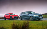 VW T-Roc R and BMW M135i - stationary side