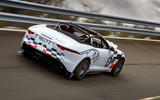 Jaguar F-Type rally car 2019 driven on the road rear
