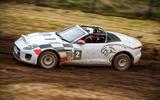 Jaguar F-Type rally car 2019 driven gravel side