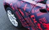 2020 Aston Martin DBX camouflaged prototype ride - side aero