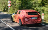 2020 Skoda Octavia prototype camouflaged drive - on the road rear