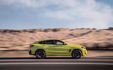 94 BMW X4 M 2021 LCI official images tracking side