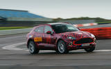 2020 Aston Martin DBX camouflaged prototype ride - cornering front