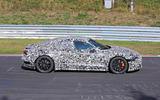 Audi E-tron GT camo track driving - side