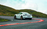 Porsche 718 Cayman GT4 driving - rear