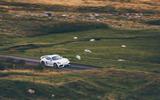 Porsche 718 Cayman GT4 driving - front side