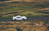 Porsche 718 Cayman GT4 driving - side