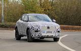 Jaguar E-Pace facelift spies side front far