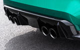The BMW M3 and M4's large diffuser and quad tailpipes leave a lasting impression