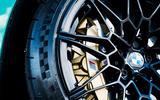BMW M Compound six-piston fixed-caliper brakes deliver impressive stopping power