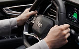 The Audi Q4 e-tron's steering wheel uses advanced touch controls with haptic feedback