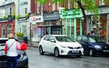 Toyota Auris driving on high street