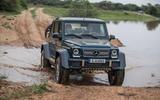 Mercedes-Maybach G650 Landaulet driving through muddy water