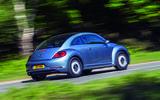 Volkswagen Beetle driving - rear