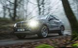 Bentley Bentayga Diesel headlights in forest