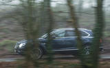 Bentley Bentayga Diesel side profile covered by trees