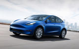 Tesla Model Y on the road blue