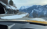 The perfect view: the long bonnet of the Toyota GR Supra and a twisty Alpine road with a dramatic backdrop