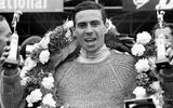 Clark with wreath and trophy