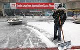 Detroit motor show - shovelling snow