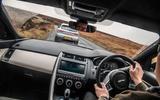 Porsche Macan vs Jaguar E-Pace 2019 - Jaguar driving inside cabin