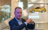 Volkswagen boss Herbert Diess talks to Autocar