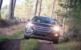 Ford Edge in muddy tracks