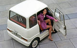 Women getting out of a Ford Comuta