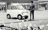 Woman next to a Ford Comuta
