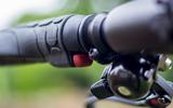 Gocycle G4's boost button is tucked away discretely on the handlebar