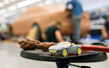 Clay modellers shape a secret car behind a 3D-printed F-Type